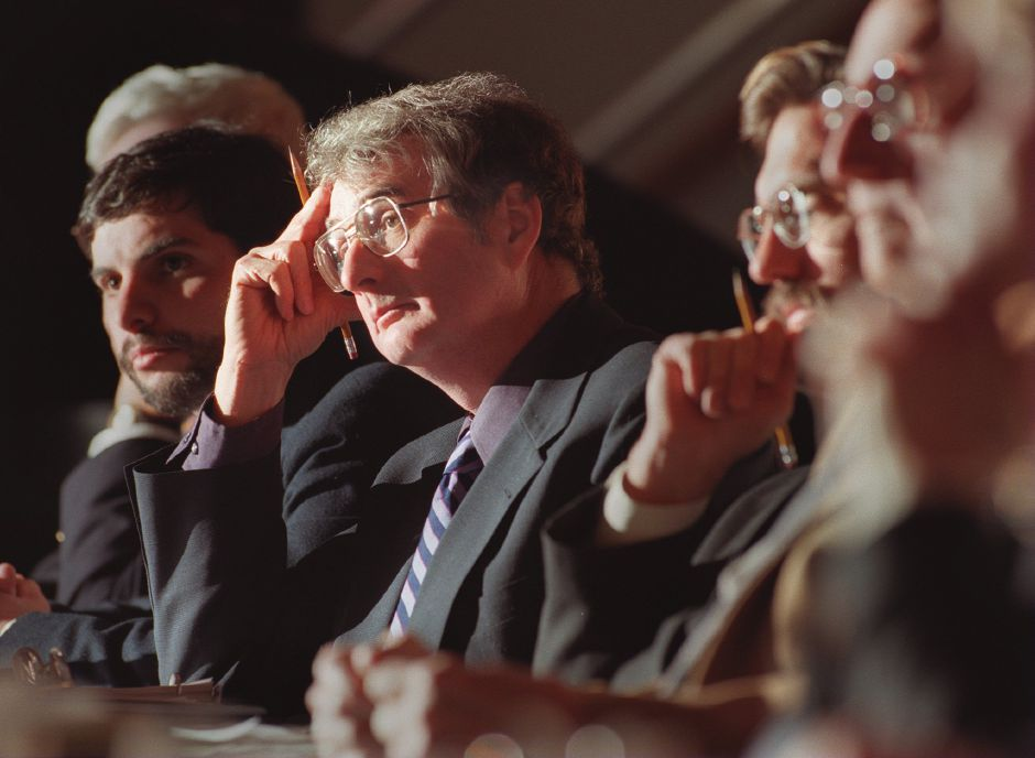 RJ file photo - Senior siting analyst Robert K. Erling, center, listens to proceedings at a hearing at Platt High School Jan. 25, 1999.