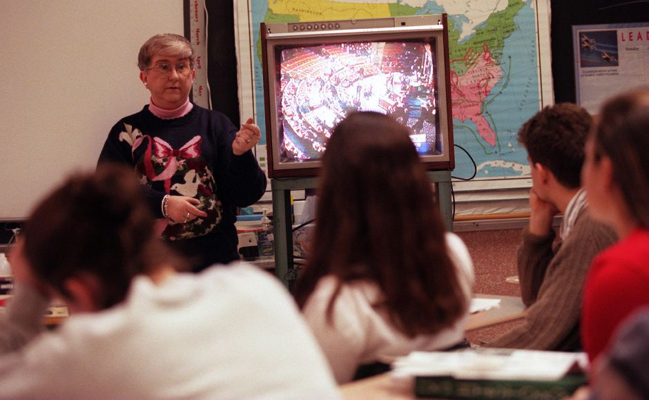 RJ file photo - Sharon Crane, in front of her AP U.S. history class at Platt, talks about impeachment, Dec. 21, 1998.
