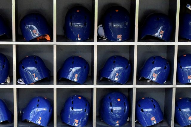 This Sept. 28, 2018 photo shows batting helmets in a rack before a Major League Baseball game in New York. According to study published Friday, May 24, 2019, NFL players may be more likely to die from brain diseases and heart problems than MLB players but the reasons are unclear. (AP Photo/Bill Kostroun)
