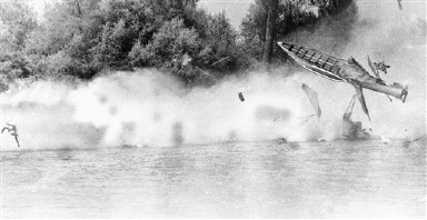 Hydroplane driver Rene Andres cartwheels through the air, left, after being thrown from his disintegrating boat on the Feather River in Oroville, California on Sunday, August 29, 1966. The West Covina, Calif., driver was hurled nearly 200 feet when his boat, Citation II, flipped and broke up. The accident occurred during a trial run before the start of race sanctioned by the National Drag Boat Association. Andres is reported in fair condition in an Oroville hospital. (AP Photo)