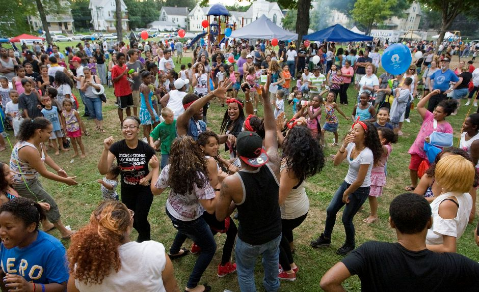 "Beat the Street Community Center dance troupes ""Collaboration"" and ""Switch-Up"", center, dance to hip-hop as hundreds gather for the seventh annual National Night Out at City Park in Meriden Tuesday August 7, 2012. (Dave Zajac/Record-Journal)"