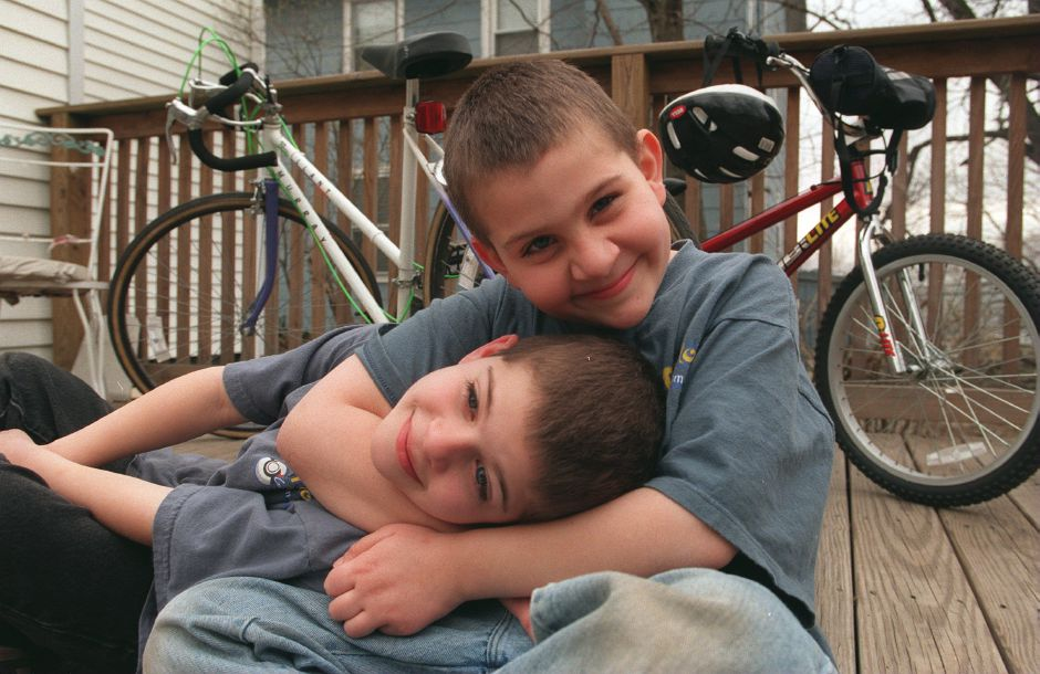 RJ file photo - Eddie Conforte, 9, hugs his brother Alex Conforte, 7, in the back yard of their Wallingford home, April 1999.