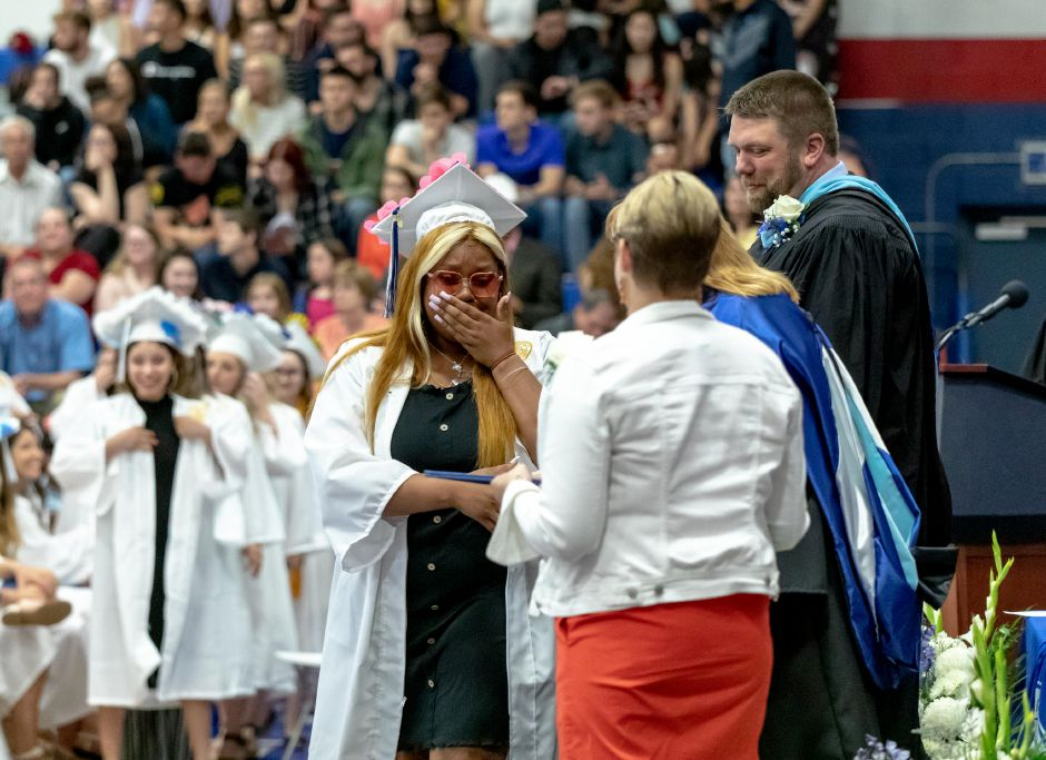 A student gets emotional as they are handed their diploma during the Plainville High School graduation ceremony, held in the school