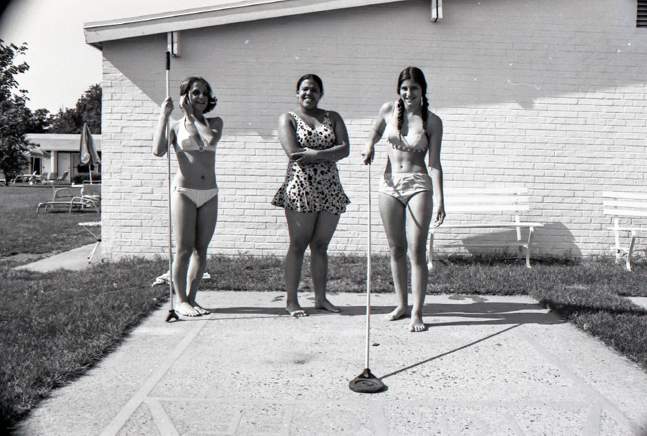 The Meriden-Wallingford Hospital honored their Candy Stripers at the Yale Motor Inn with a pool party along with those volunteers who contributed more than 25 hours of volunteer time. From left, Barbara Passarelli, Ivette Vazquez and Debra Beddingfield tried their hand at Shuffleboard, July 30, 1975.
