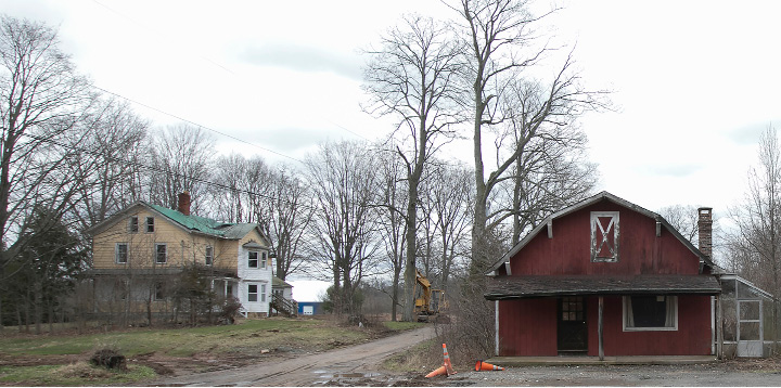 The former Ives homestead, left, and barn on the former Chapman property next to Bartlem Park in Cheshire, Friday, April 7, 2017.  |  Dave Zajac, Record-Journal