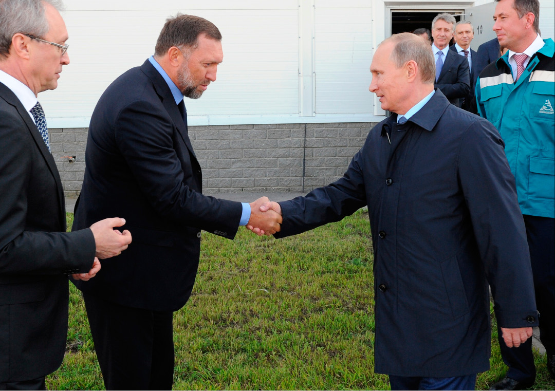 FILE - In this Sept. 19, 2014 file-pool photo, Russian President Vladimir Putin, right, shakes hands with Russian metals magnate Oleg Deripaska while visiting the RusVinyl plant in Kstovo, in Russia
