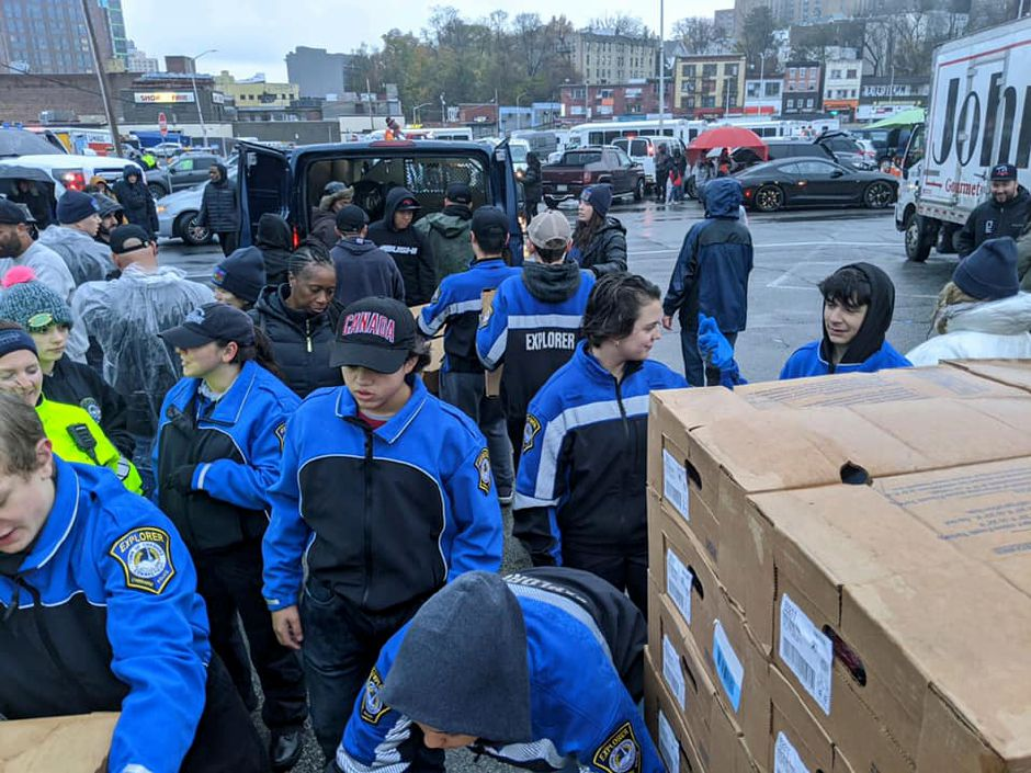 Members of the Cheshire Police Explorers Program handed out turkeys in Yonkers, New York, the Sunday prior to Thanksgiving. Submitted photo.