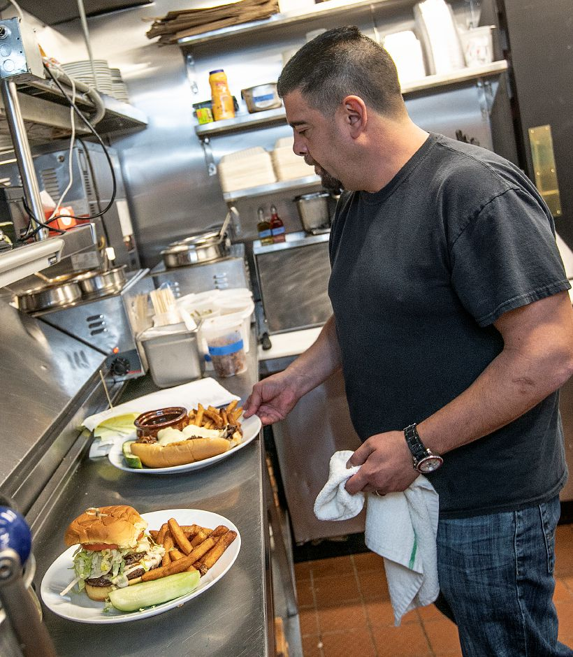 Co-owner Stephen Barraco works in the kitchen during lunch at Amici Tavern, 43 Broadway, North Haven, Wed. Feb. 6, 2019. Dave Zajac, Record-Journal