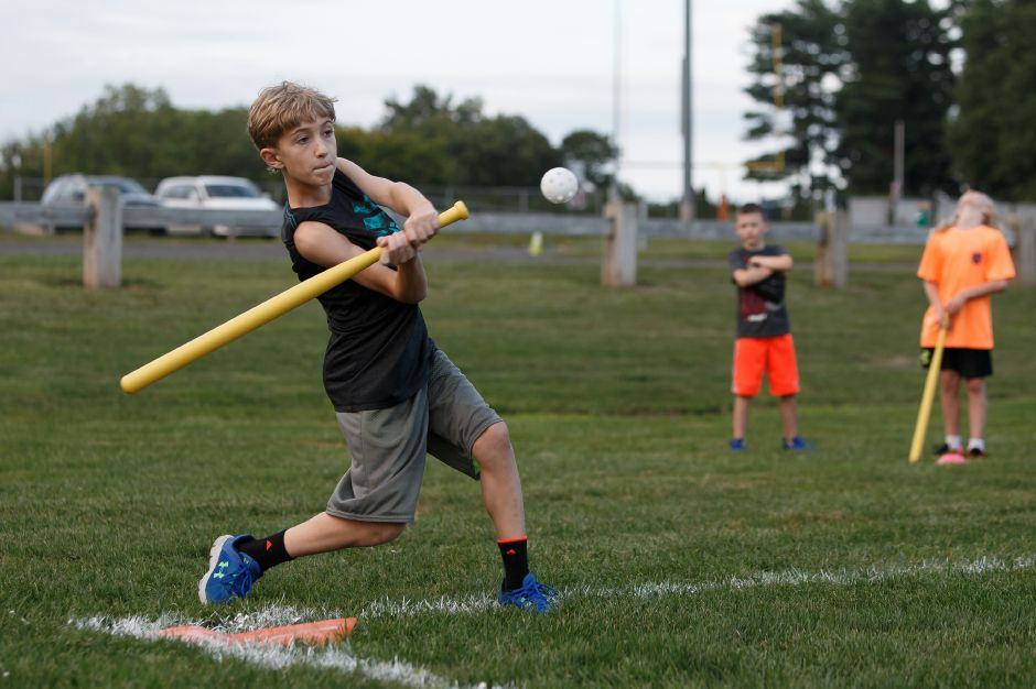 Keegan Grace 11 takes a swing in a whiffle ball game with the Southington baseball team Saturday at the Southington Drive In hosted by Bread for Life in Southington September 1, 2018 | Justin Weekes / Special to the Record-Journal