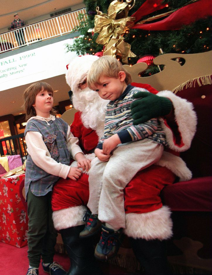 RJ file photo - Santa initially gets the silent treatment from Nikolas Ferony of Meriden at the Meriden Square mall Dec. 1998. His big sister Leandra Ferony looks on.