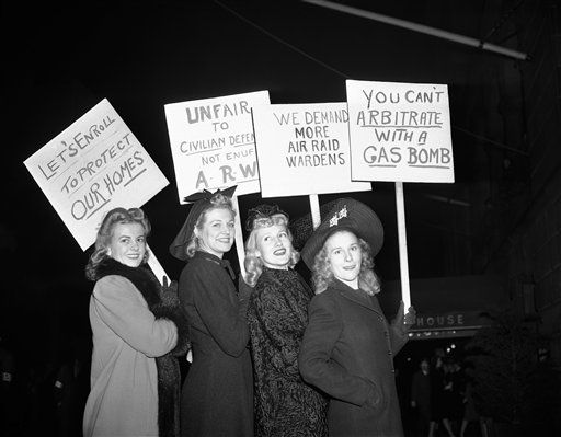 Four pretty models carry signs at a New York Air Raid warden demonstration Nov. 17, 1941 calling for recruits to the ranks of raid wardens. Left to right: Frances Herring, Helen Bent, Ruby Stevens and Gloria Donaldson. (AP Photo)