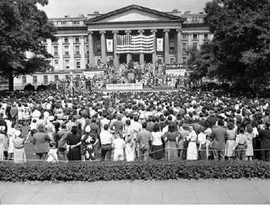 Packing the plaza and steps at the Treasury Department in Washington on August 31, 1942, thousands cheered the film stars who came to open the government's September war bond drive. The stars autographed bond applications. An estimated $1,500,000 worth was subscribed for. (AP Photo)
