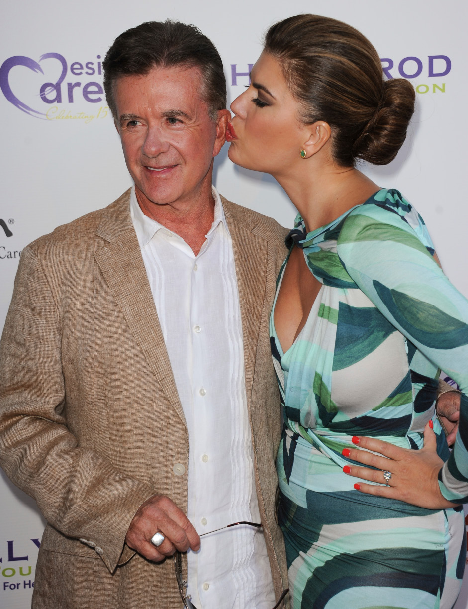 FILE - In this Saturday, July 27, 2013 file photo, Alan Thicke, left, and his wife, Tanya Callau, arrive at the 15th Annual DesignCare in Malibu, Calif. On Tuesday, Dec. 13, 2016, a publicist said Thicke has died at the age of 69. (Photo by Richard Shotwell/Invision/AP)