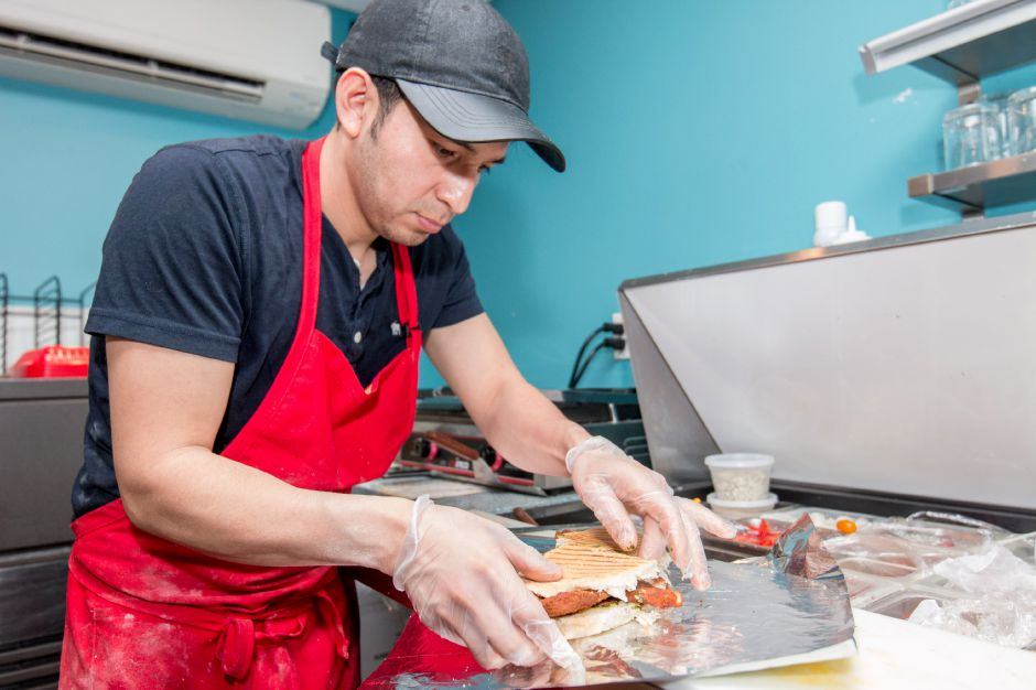 Ermel Idrovo, 32, of Wallingford, prepares a chicken panini at Anthony