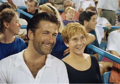 Actor Alec Baldwin and tennis star Monica Seles enjoy the match between Michael Chang and John McEnroe at the U.S. Open in New York, Aug. 31, 1991.  (AP Photo/Mark Lennihan)