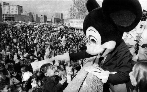 Some 1,000 persons turned out in Albuquerque, New Mexico to greet Mickey Mouse on Nov. 14, 1978, as he celebrates his 50th birthday with a whistle-stop train tour. (AP Photo/John Holmes)