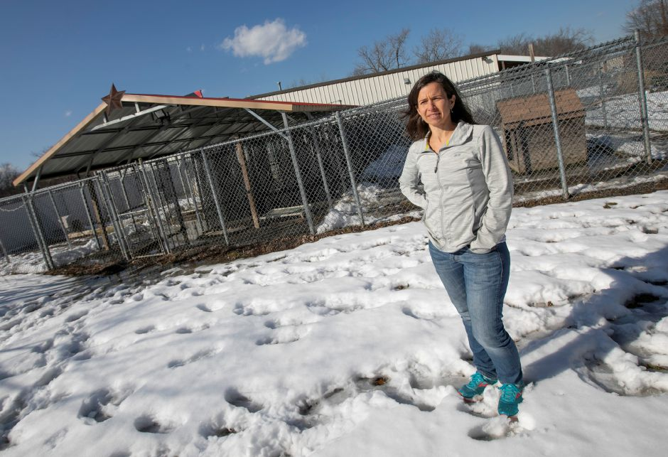 Julie Rogers, volunteer coordinator, stands in front of dog kennels at the Meriden Humane Society, Mon., Mar. 11, 2019. Eversource has donated funds to resolve a recurrent flooding issue in the kennel area of the Meriden Humane Society. Dave Zajac, Record-Journal
