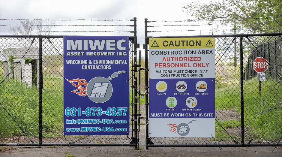 An entrance gate to the former Bristol-Myers Squibb property off Barnes Road in Wallingford, Fri., May 24, 2019. Demolition began on the facility this week. Dave Zajac, Record-Journal