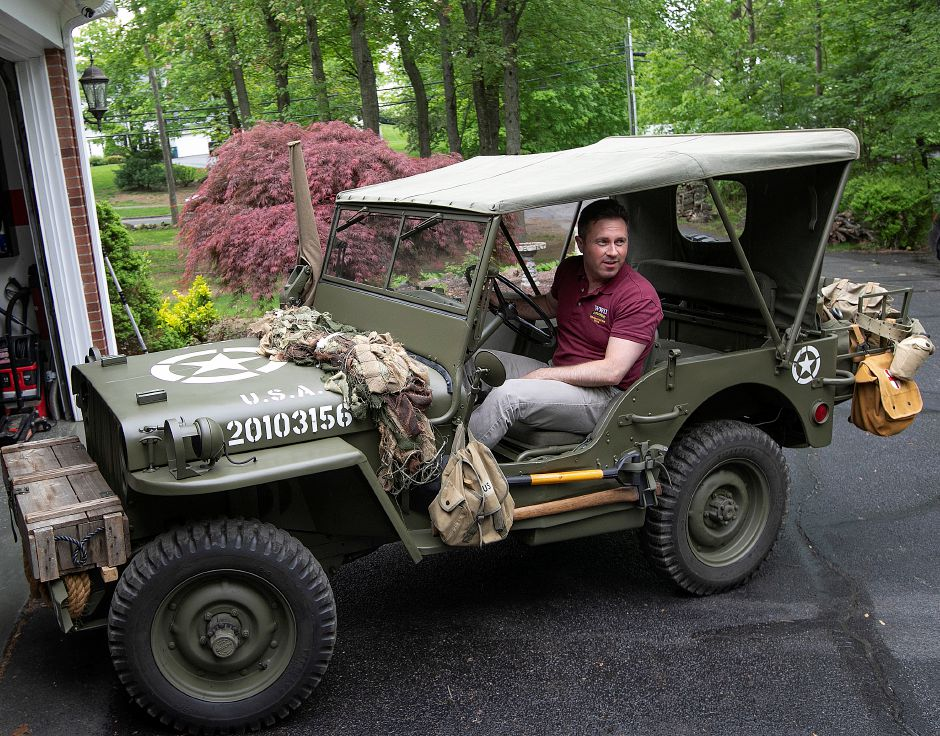 Matt Jalowiec, of Cheshire, sits in his 1942 Ford GPW jeep at his residence, Fri., May 17, 2019. Jalowiec will join about 600 others in France next month to reenact the paratroop landing during the D-Day invasion during World War II. Dave Zajac, Record-Journal