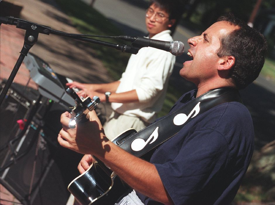 RJ file photo - Denis Bonito sings and plays guitar ando nthe left, Jonathan Chin plays keyboard as part of the Top of the Key band that was performing on the sidewalk in front of the Wallingford Family YMCA for Camp Pequot campers, Aug. 1998.