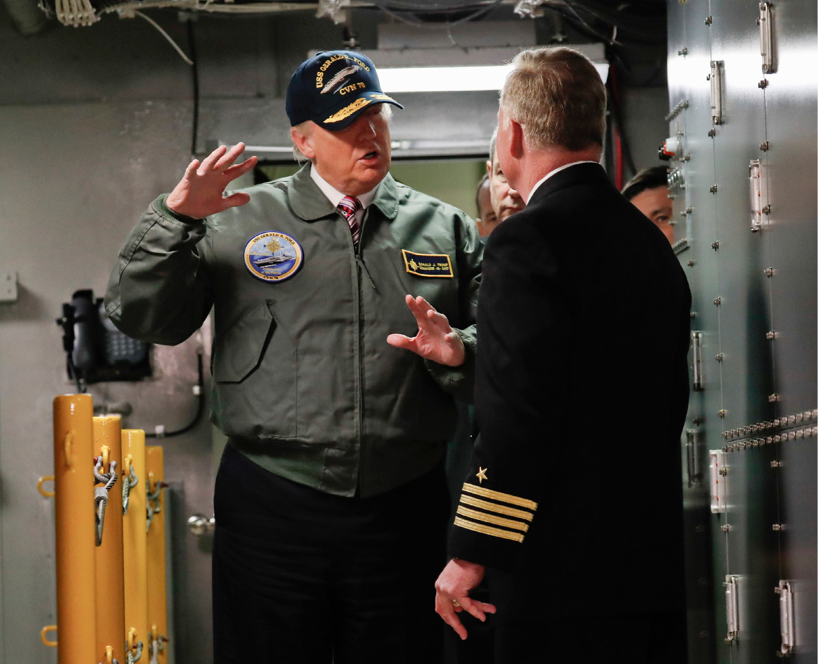"President Donald Trump talks with Capt. Richard ""Rick"" McCormack during a tour of the nuclear aircraft carrier Gerald R. Ford, Thursday, at Newport News Shipbuilding in Newport News, Va. 