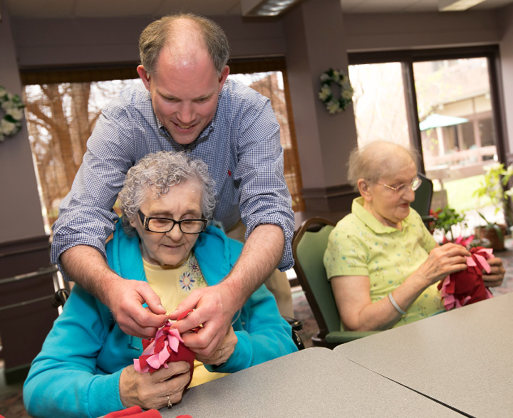 Jon Stempien, recreation manager, helps senior Marie McGourn make a heart pillow at the Miller Memorial Community in Meriden, Wednesday, April 19, 2017. The pillows will be delivered to the Connecticut Children