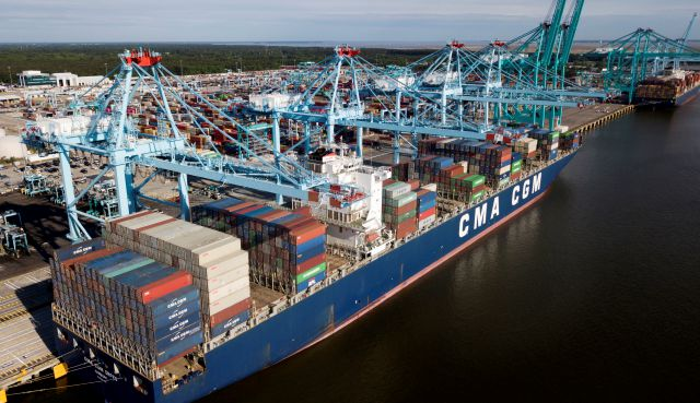 FILE - In this May 9, 2019, file photo a container ship is unloaded at the Virginia International Gateway terminal in Norfolk, Va. China has announced tariff hikes on $60 billion of U.S. goods in retaliation for President Donald Trump