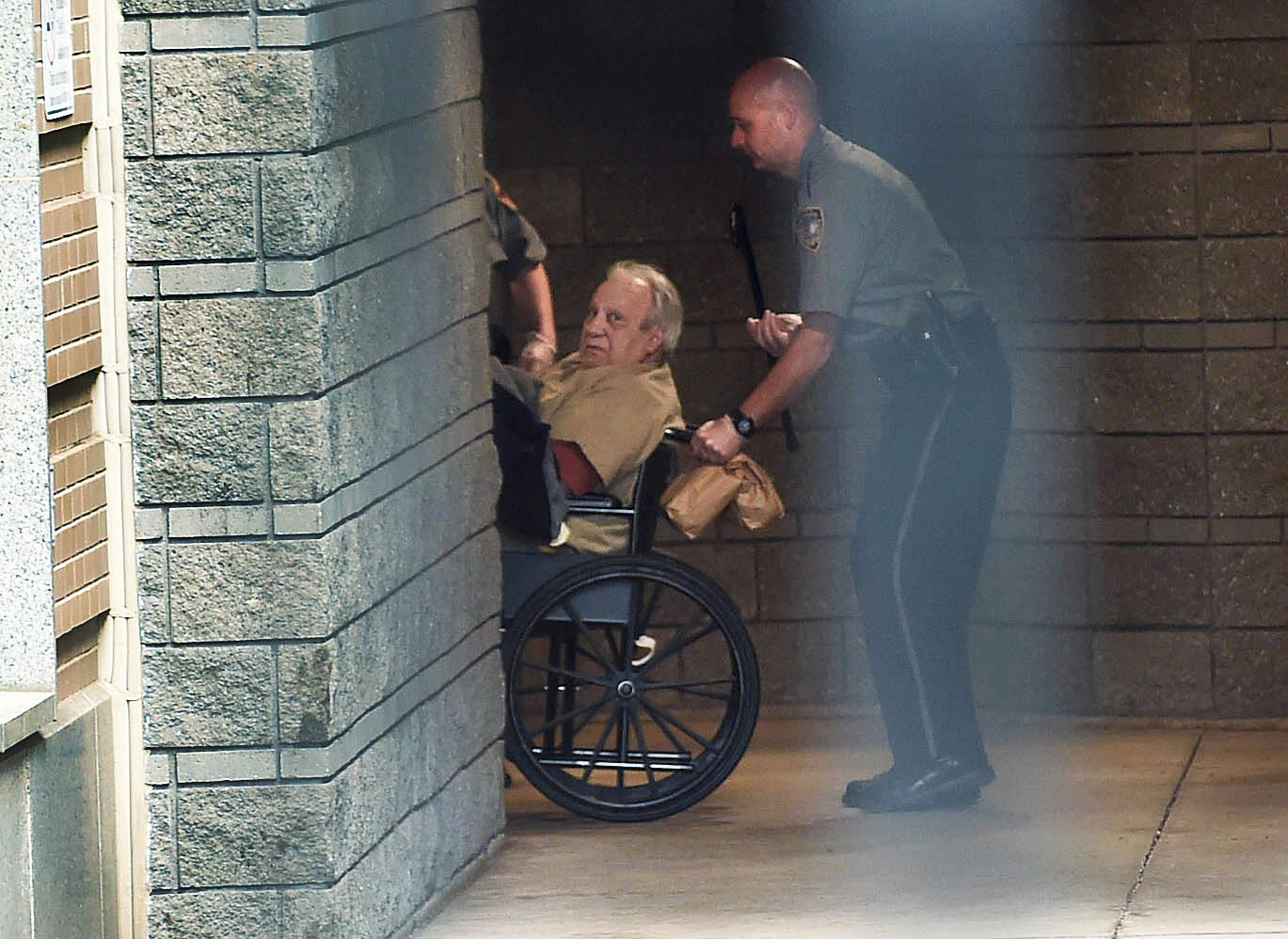 FILE - In this April 20, 2015 file photo, Robert Gentile is brought into the federal courthouse in a wheelchair for a continuation of a hearing in Hartford, Conn. Gentile, a reputed Connecticut mobster who authorities say is the last surviving person of interest in the largest art heist in U.S. history has agreed to plead guilty to unrelated weapons charges. The Hartford Courant reports the plea agreement was reached Tuesday, March 28, 2017, in 80-year-old Gentile