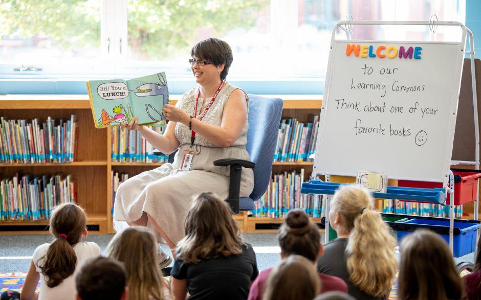 "Librarian Denise Poole reads ""I Yam A Donkey"" to her first class at Willard Elementary School on August 29, 2018. The school transformed its library into a learning commons with a greater emphasis on technology. 