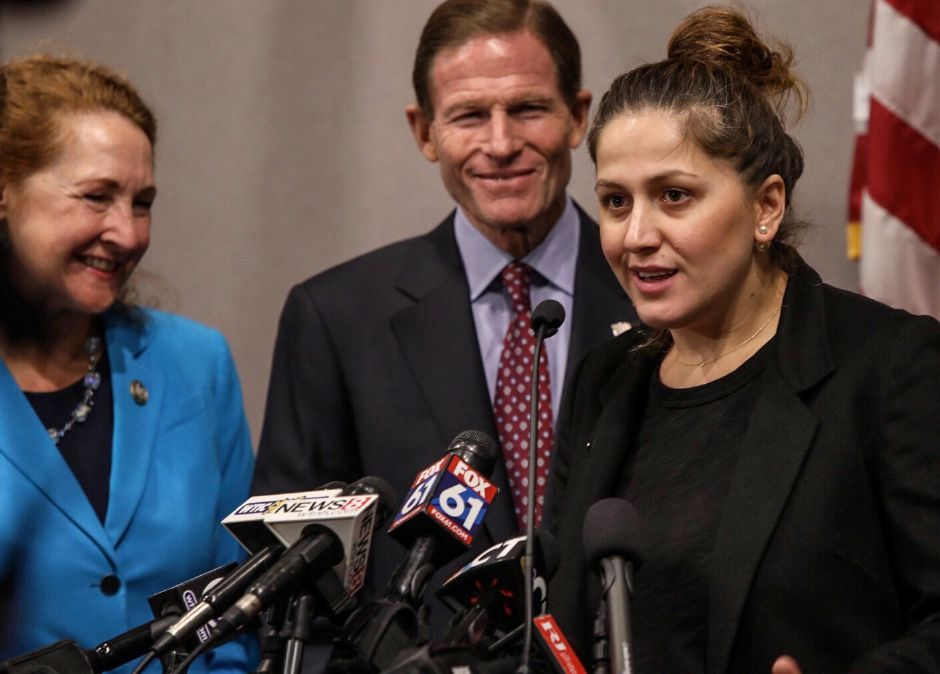 Denada Rondos stands near U.S. Sen. Richard Blumenthal and U.S. Rep. Elizabeth Esty while addressing the media about being able to stay in the country while a court hears her appeal. | Dave Zajac, Record-Journal staff