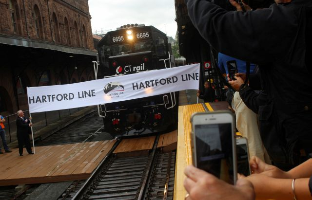 A CTrail train from New Haven, Conn., breaks a ceremonial tape at Hartford