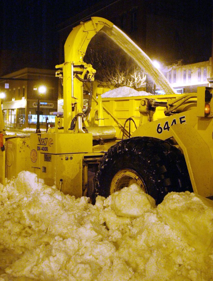 Meriden Public Works crews were hard at work at 1AM Thurs. morning removing snow from the sides of West Main St. in Downtown Meriden. They reportedly started working at 9:00 PM Wed. and were working through to 7:00 AM Thursday, Jan. 9.