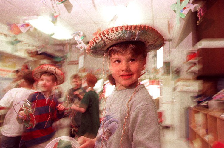 RJ file photo - Alec Lynde, 5, right, and Herb Knight, celebrate Cinco de Mayo in Kathy Jaworski and Nancy Germain