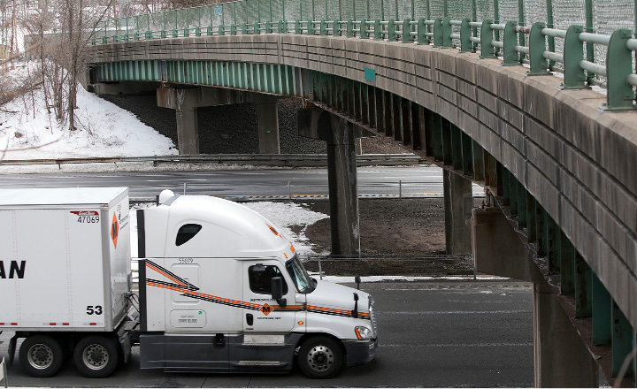 A tractor-trailer travels under the Harrison Road bridge Tuesday on Interstate 91 south in Wallingford. Bridge repair work will begin next month.  | Dave Zajac, Record-Journal