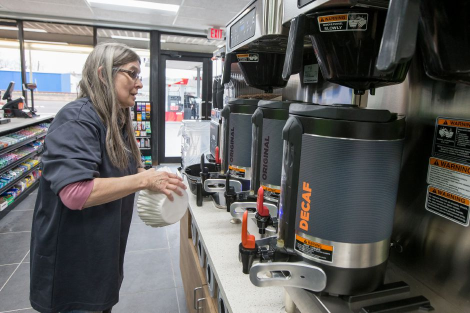 Store manager Phyllis Phelps makes a pot of coffee Monday at the new Dunkin' Donuts kiosk at the Citgo gas station on Route 5 in Wallingford. Justin Weekes, special to the Record-Journal