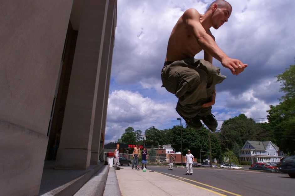 Justin Waller, 17, of Southington, does a type of grab, a type of trick, while flying through the air on his inline skates at Derynoski School in Southington Monday Aug. 16, 1999. He and other skaters think the town should build them a skate park.
