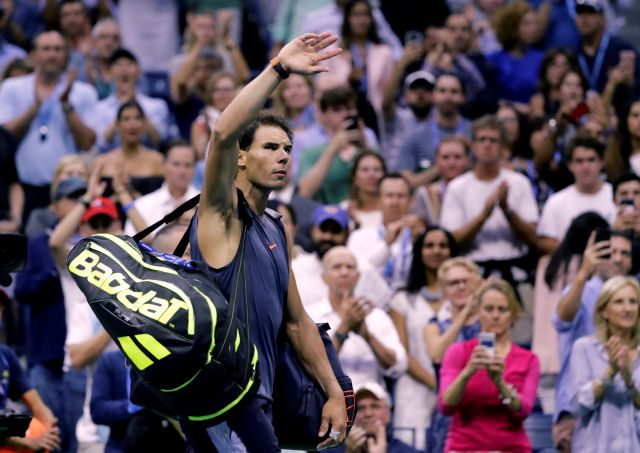 Rafael Nadal, of Spain, waves to fans after retiring from a match against Juan Martin del Potro, of Argentina, during the semifinals of the U.S. Open tennis tournament, Friday, Sept. 7, 2018, in New York. (AP Photo/Seth Wenig)