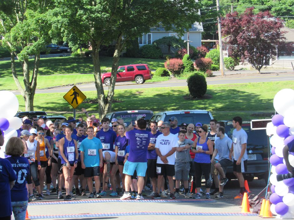Runners at the starting line get ready to start in the Pancreatic Cancer Action Network's the Purple Stride walk in Hubbard Park. Saturday, June 15, 2019. | Jeniece Roman, Record-Journal