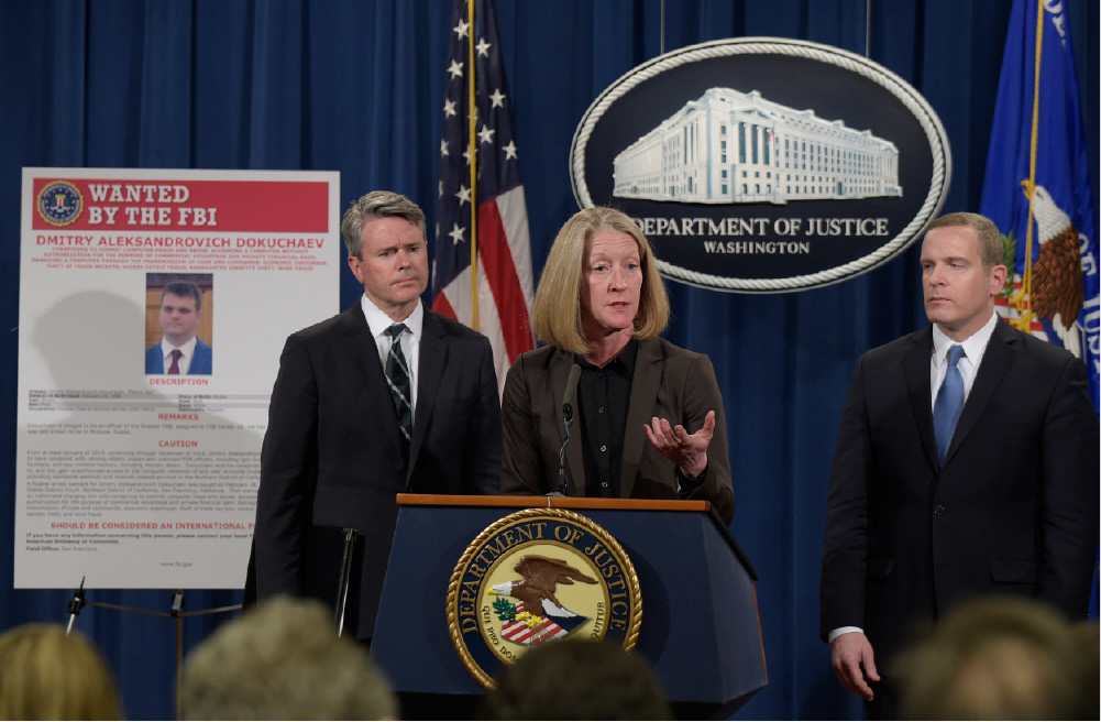 Acting Assistant Attorney General Mary McCord, center, accompanied by U.S. Attorney for the Northern District Brian Stretch, left, and FBI Executive Director Paul Abbate, speaks during a news conference at the Justice Department in Washington, Wednesday, March 15, 2017. The Justice Department announced charges against four defendants, including two officers of Russian security services, for a mega data breach at Yahoo. (AP Photo/Susan Walsh)