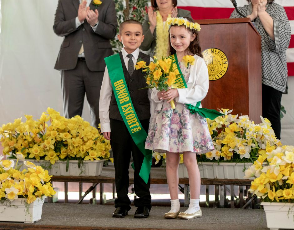 Ben Franklin Elementary School student Scarlett Gibbs, 7, is crowned Miss Daffodil at a ceremony on April 24, 2019. Gibbs will lead the Meriden Daffodil Festival Parade on April 27, being escorted by Israel Putnam student Kayden Rodriguez, 8, left. | Devin Leith-Yessian/Record-Journal