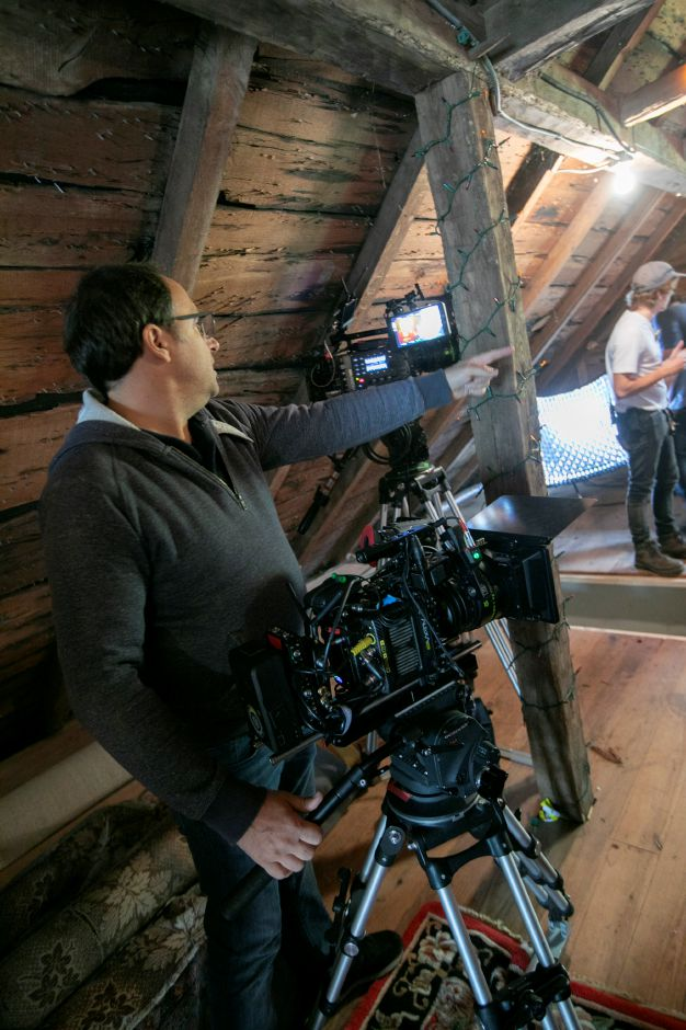"Director of Photography Patrice Clochet works on the set of ""My Adventures With Santa,"" in Middletown, Friday, Oct. 19, 2018. Film crews are shooting scenes in the greater Meriden area for the Christmas movie to be released in 2019. Dave Zajac, Record-Journal"