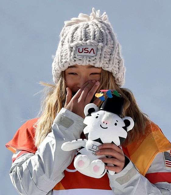 Chloe Kim, of the United States, wipes away a tear after winning gold in the women
