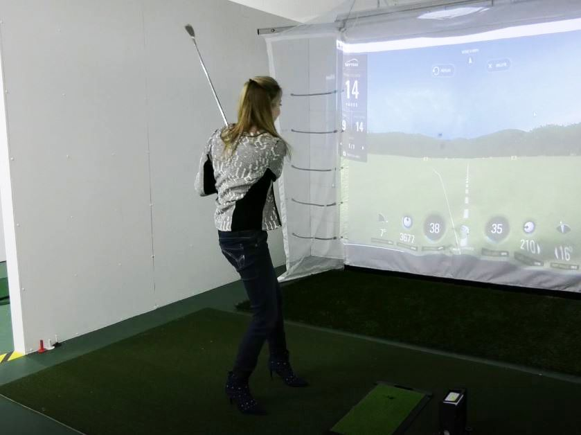 Record-Journal Digital Content Producer Ashley Kus takes a swing at the new golf simulator located at the Meriden YMCA, 110 W. Main St., Meriden. Friday, March 8, 2019. |Ashley Kus, Record-Journal
