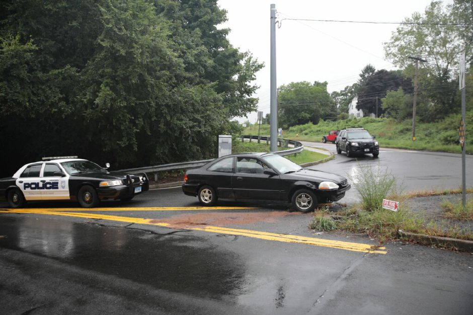 Emergency crews responded to reports that a car hit a pole on Chamberlain Highway in Meriden Wednesday evening. | Devin Leith-Yessian, Record-Journal