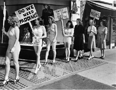 Members of the Women's Organization to War on Styles (WOW) picket a dress shop in Berkeley, Calif., Aug. 23, 1947, in protest to longer skirts and padded hips. They are the wives of GI students at the University of California. Left to right: Jackie Houser; Wanda Ames; Dorothy Inman; Terry Ligon; Ruth Van Arkel; Carrol Reynolds, and Barbara Carmichael. (AP Photo)