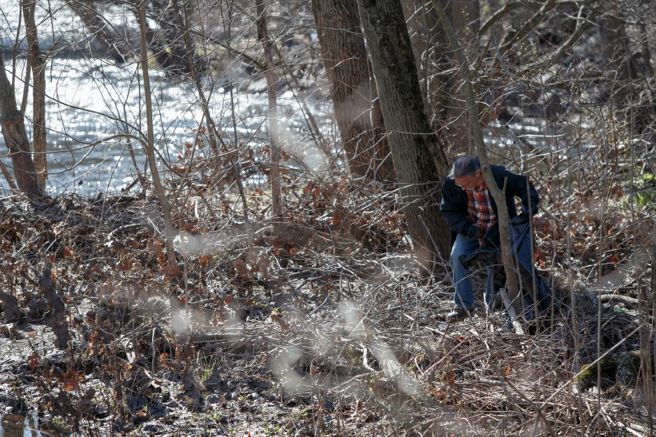 Paul Goodmaster of Wallingford walks the banks finding trash Saturday during the Quinnipiac River Watershed Association Spring Source to Sound River Cleanup at Westbrook Lobster in Wallingford April 21, 2018 | Justin Weekes / Special to the Record-Journal
