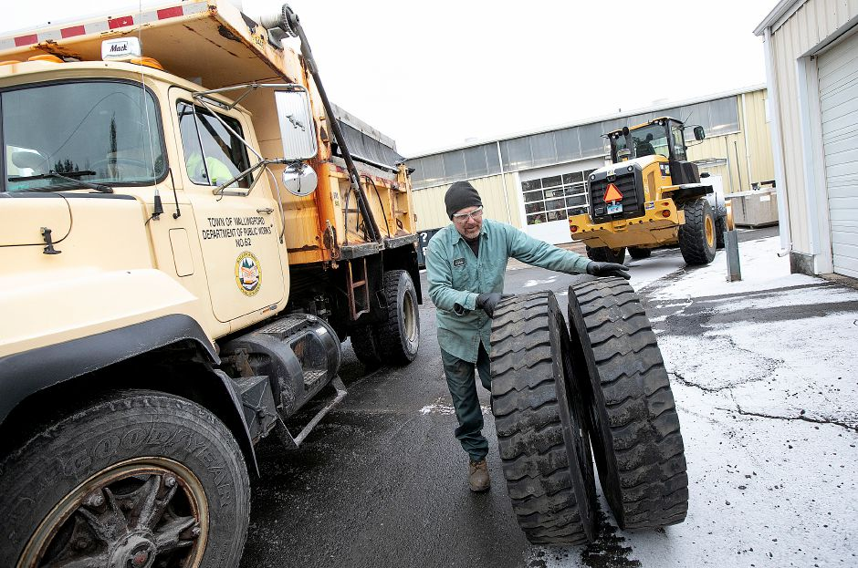 A mechanic changes out used tires as Wallingford Public Works crews prepare for the incoming storm, Fri., Jan. 18, 2019. State and local officials advise area residents to prepare for a mixture of snow and sleet predicted to fall throughout the weekend. Dave Zajac, Record-Journal
