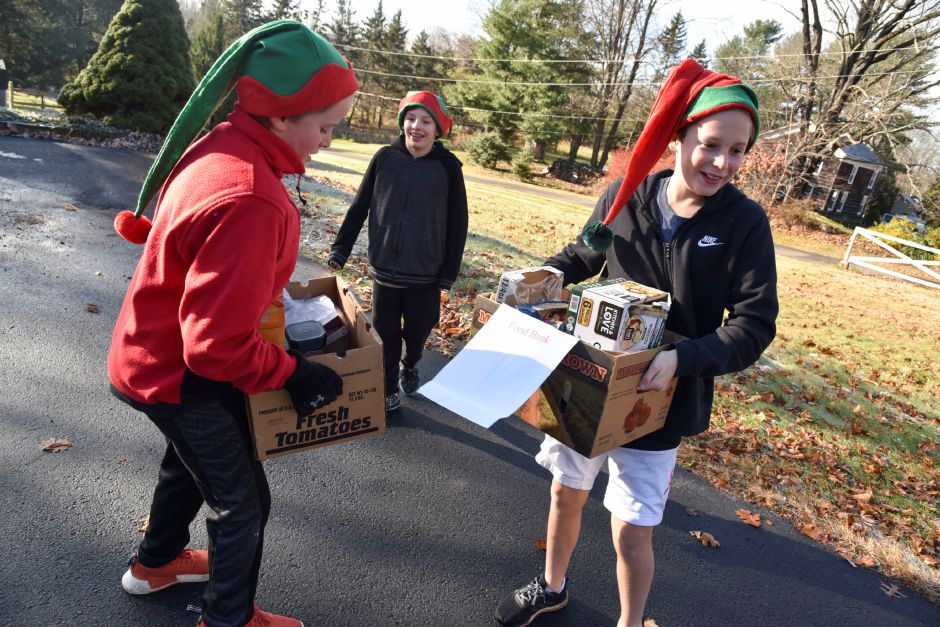 Clayton Wiseman, 12, helps Eli Wiseman, 10, carry boxes of donations during the 13th annual Community Round-up in Durham and Middlefield on Saturday, Dec. 1. | Bailey Wright, Town Times