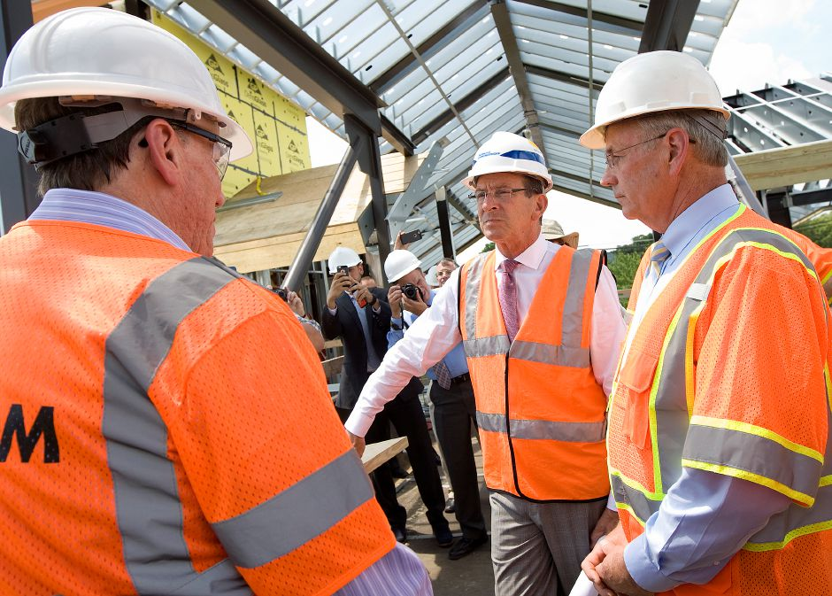 Governor Dannel P. Malloy and DOT Commissioner James Redeker, right, tour the Wallingford train station, Wednesday, July 6, 2016. After the short tour, Malloy provided an update on the Hartford Line expected to be completed by January 2018. | Dave Zajac, Record-Journal