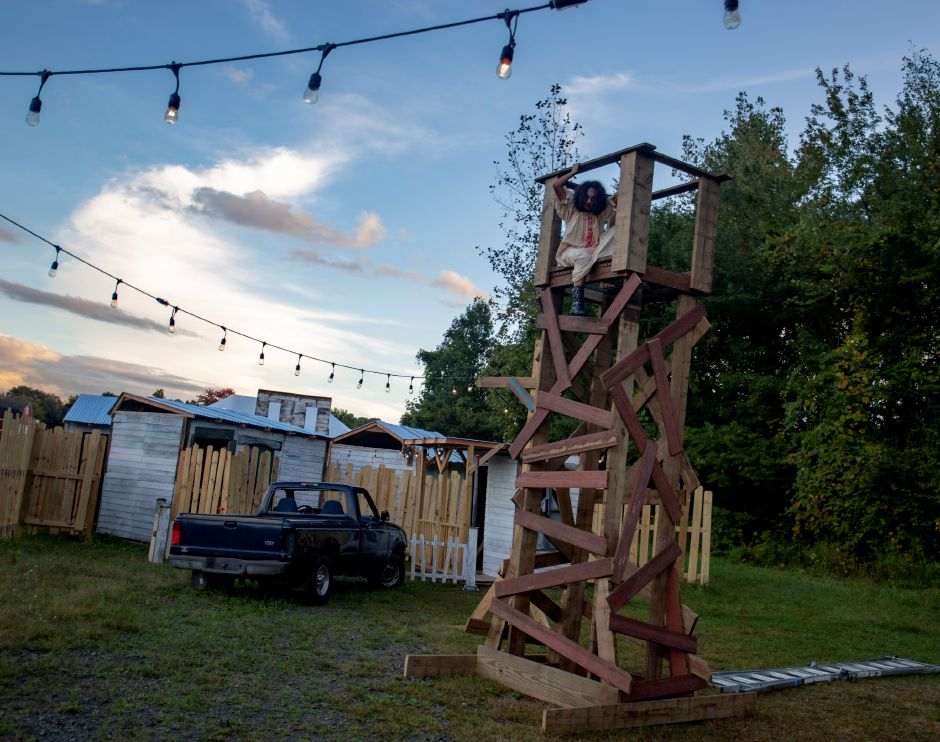 Olivia Donis, 13, sits in a tower near the entrance to the Haunt on Eden in Southington Oct. 3, 2018. | Richie Rathsack, Record-Journal